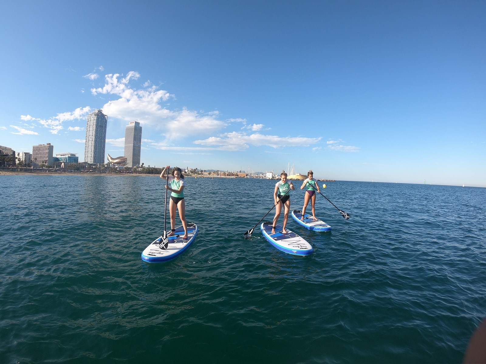 Speakeasy student stand-up paddle boarding