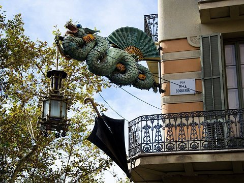 Iron Chinese dragon sculpture on a building in Barcelona
