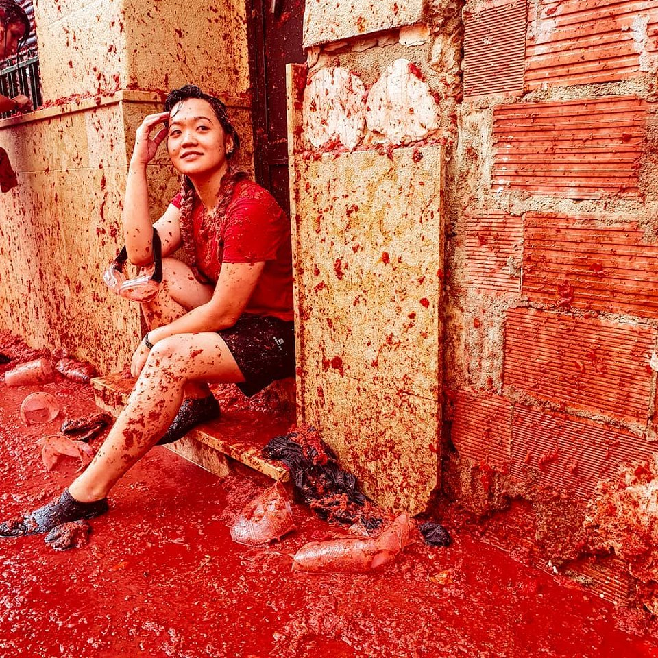Girl sitting in doorway with tomato juice everywhere