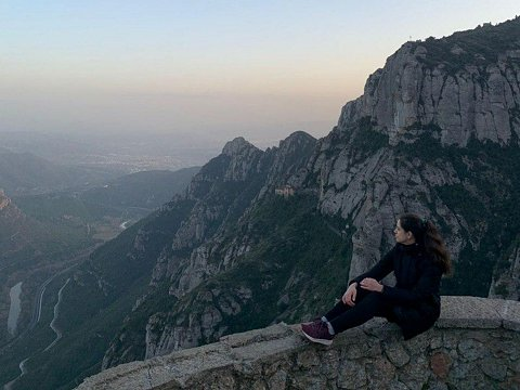 Girl sitting and taking in views of Montserrat mountain