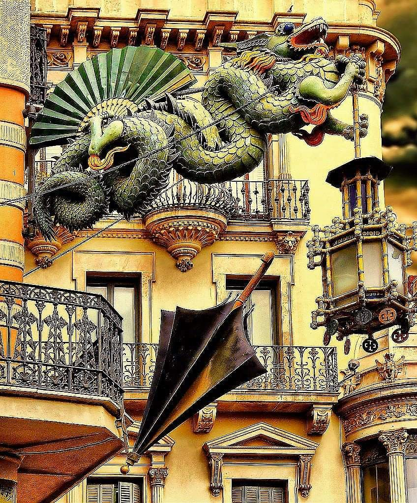 Dragon sculpture in front of a building in Barcelona