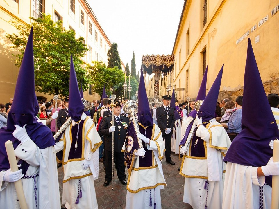 Traditional brotherhood with capirotes in Spanish Easter procession
